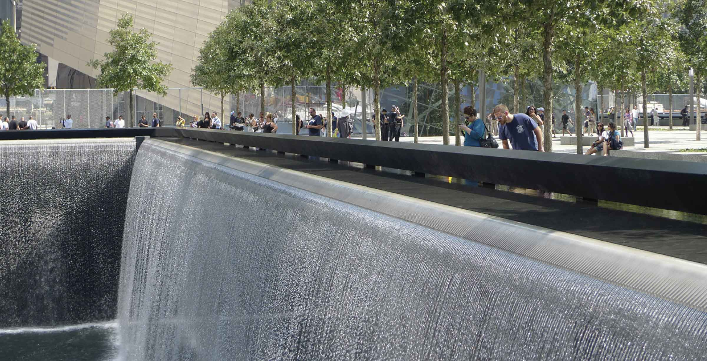 man looking down waterfall at September 11th memorial
